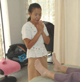 Praying to the Father Doctor at start of Thai Massage